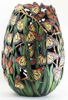 Carved and Painted. There are 106 butterflies on this gourd. Artist Phyllis Sickles.