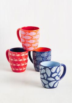 Ready to ride the waves of whimsical kitchenware? Dive spoon-first into the nautical stylings of these printed mugs! In sky, navy, orange, and red hues, this ceramic set boasts a bounty of fish, oysters, and flamingos, answering your dining and decorating needs in a 'splash'!