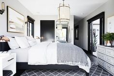 Modern bedroom with a muted color palette, and a lantern over the bed