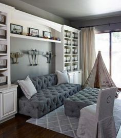 Kids playroom with reading Nook. Grey Kids playroom with reading Nook. Kids playroom with reading Nook Sofa and ottoman is from Restoration Hardware #playroom #readingNook kids-playroom-reading-nook The Refined Group