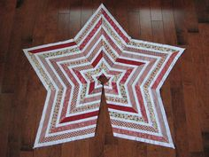I quite like this star tree skirt from Paul's Block Party.