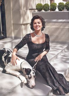 The beautiful operatic soprano Anna Netrebko (la bellissima), photographed for a magazine, with a very cute dog.
