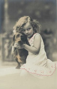 Vintage photo of girl cuddling her dachshund. #dogs #pets #Dachshunds…