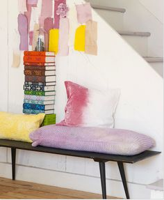I love colorful texture designs on books! I would stack them up on a chair in the foyer!