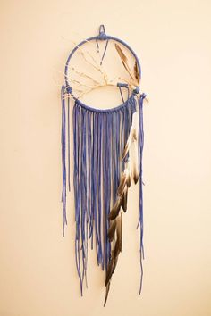 Handmade, modern dreamcatcher great for living room decor, bedroom decor, nursery decor, gifts, and, of course, sweet dreams.  The center ring is 10