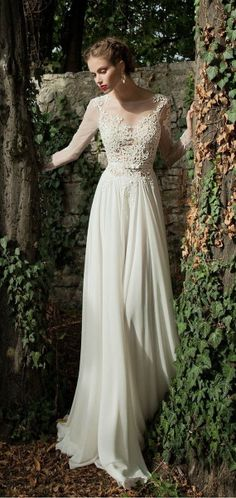 Dreamy Lace neckline with  an A-line flowing skirt.