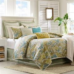 Turn your bedroom into a coastal retreat with the Hampton Hill Rainforest collection. The duvet style comforter and shams feature a woven jacquard design of palm leaves in tonal sage green, blue and yellow colors. A soft sage green cotton bed skirt accented with an ivory trim is included in the set. The three Euro shams feature a geometric design that is embroidered against a ivory cotton ground and is accented with a soft green flange. Three embellished and textured decortive pillows…