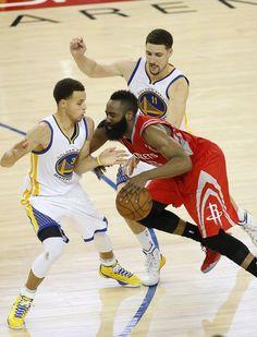 Houston Rockets guard James Harden, center, loses the ball on the game's final play as he is guarded by Golden State Warriors guard Stephen Curry, left, and guard Klay Thompson during the second half of Game 2 of the NBA basketball Western Conference finals in Oakland, Calif., Thursday, May 21, 2015. The Warriors won 99-98. (AP Photo/Tony Avelar) Photo: Tony Avelar, Associated Press