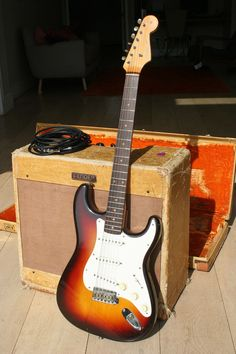 fender guitars 1959 Stratocaster (Rosewood fretboard but Single-Ply Pickguard) and 1959 Fender Bassman Amplifier Fender Stratocaster, Fender Guitar Amps, Fender Electric Guitar, Cool Electric Guitars, Gibson Guitars, Acoustic Guitar, Bass Guitars, Learn Guitar Chords, Guitar Songs