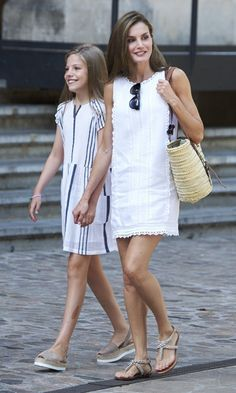 <h4>AUGUST</h4> The Queen of Spain and her daughter Sofia looked summertime ready, Letizia in a white linen dress and her 10-year-old in a striped dress and trendy platform sandals. <p>Photo: Getty Images