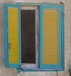 Turquoise and yellow shutters