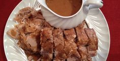 Slow Cooker Cola Pork Roast - Simple to make and so deliciously tender and moist!  YUMMY!  www.GetCrocked.com