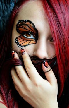 love this its so cool. monarch butterfly inspired eye makeup.