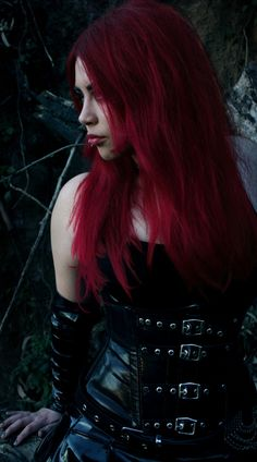 Crimson hair and vinyl with buckles set her apart...