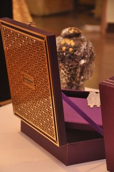 regal purple and gold, deep eggplant colored raw silk box with laser cut metallic detailing cover.