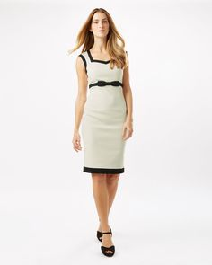 A monochrome fitted dress with contrast edging, an empire seam bow detail and square neck. Fully lined with a centre back zip and vent.