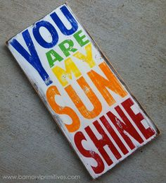 You Are My Sunshine Sign Typography Word Art in Rainbow Colors Heavily Distressed. $100.00, via Etsy. This would be perfect for AJ and Sam's room.