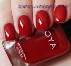 Zoya nail polish in the color Rekha, medium red with blue undertone. Designer Collection Fall 2012 -- custom shade created for use in Bibhu Mohapatra's fall fashion week runway show.