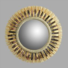 """Line Vautrin sunburst mirror, 230 mm. or just over 9"""" wide. Ivory Talosel with golden and purple glass. #sunburst mirror #starburst mirror"""