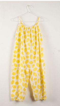 Just know she will love wearing this lemon romper all summer long; so joyful, light, and full of fun.  The soft crepe will keep her cool while she enjoys each and every lazy day of summer. Lemon crepe romper, Bobo Choses Spain #Designer #Luxury #baby #girls #fashion #sunsuits  $89