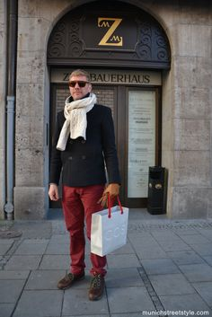 Wear a navy pea coat and burgundy chinos if you're going for a neat, stylish look. Keep it matchy-matchy with brown leather boots.  Shop this look for $334:  http://lookastic.com/men/looks/scarf-and-pea-coat-and-gloves-and-chinos-and-boots/600  — White Scarf  — Navy Pea Coat  — Tan Leather Gloves  — Burgundy Chinos  — Brown Leather Boots