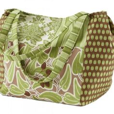 Sew up a spacious bag that meets all your needs. Two sets of inside pockets have room for keys, a notebook, a cell phone, and a planner, making this roomy carryall the perfect size for taking along on an all-day outing. Project maker Judy Sams Sohn chose eye-catching bold prints from the Santorini collection by Lila Tueller for Moda Fabrics.