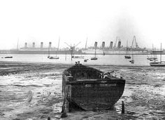 Mauretania (right) and Olympic (left) in 1935, awaiting their final voyage to the scrapyard.