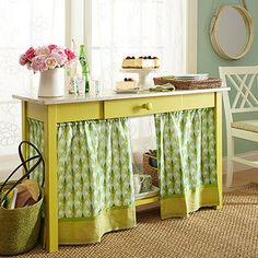 Repurpose an old desk as a new storage unit. Store party dishes on the bottom shelf and keep napkins and other linens in a wicker basket for easy access. Hide the shelf behind a festive curtain, and your buffet combines function and fashion