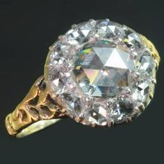 *Antique engagement ring with big rose cut diamond engird by smaller rose cuts, Circa 1870.