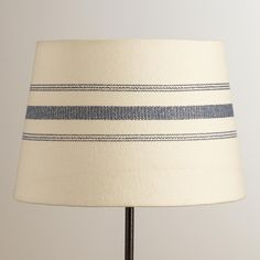 Printed with clean, simple blue lines on a white ground, our exclusive lamp shade adds a fresh look to your decor and pairs with any of our accent lamp bases.