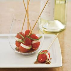 Fun presentation for these mini Caprese bites! Even when luscious Summer tomatoes aren't available, cherry tomatoes often are. The combination of olive oil, basil, mozzarella and tomato can be enjoyed year round.