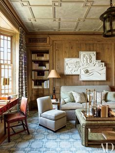 In the library, a Louise Nevelson sculpture is displayed above an S. R. Gambrel sofa; on the cocktail table is a Steven Gambrel–designed tray | archdigest.com