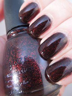 China Glaze Lubu Heels   A black jelly base with red micro glitter   On my wish list :)
