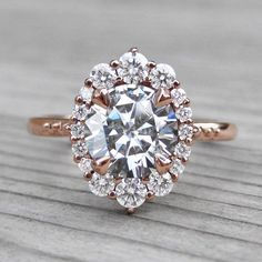 It's perfect* Peach Champagne Sapphire Engagement Ring & Diamond Halo Beautiful Engagement Rings, Halo Engagement Rings, Vintage Engagement Rings, Beautiful Rings, Coloured Engagement Rings, Peach Saphire Engagement Ring, Unique Rings, Peach Champagne Sapphire, Champagne Ring