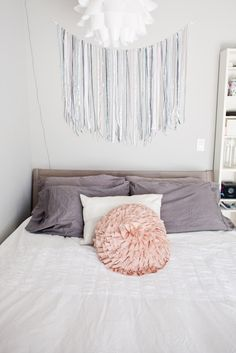 DIY ribbon garland wall hanging - this is easy-to-make art for the bedroom and could be done in so many different colors.
