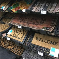 This Wall of Welcome Mats Productstop Upgrade concept employs a Declined approach to maximize visibility. But the Productstop is of a enhanced design. Visual Merchandising Displays, Welcome Mats, Carpet Design, Ideas Para, Showroom, Wall, Retail, Business, Cute Room Decor