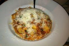 Tagliatelle Bolognese Covered In Parmesan Cheese At Louise's Trattoria On Larchmont Boulevard In Los Angeles, CA.