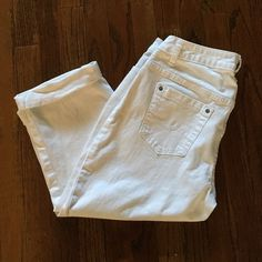 white crop jeans  Never worn. Excellent condition. Making room in my closets. Smoke and pet free home. If you have any questions feel free to ask. Fashion Bug Jeans Ankle & Cropped