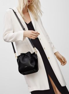 AUXILIARY MINI MANDER BUCKET - A contemporary bag in rich leather for all of your belongings