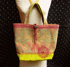One of a kind tapestry and velvet tote bag. Hand dyed vintage lace trim and doily. Hand dyed ribbon yarn.