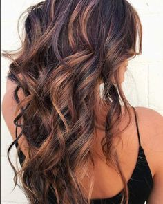 See the best fall hair colors and trends like cold brew hair, flannel hair, Blonde with red undertones, Warmed-up brunette, Rose gold, Maroon glaze, Orange ombre, Platinum balayage, Strawberry blonde, Caramel highlights, and Dark purples and blues. See examples and get inspiration for your next salon visit.
