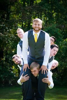 Boys will be boys! Fun & unique groomsmen poses, wedding photography, large wedding party, yellow and gray color scheme