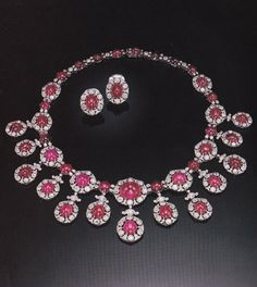 Cartier - A very fine antique cabochon ruby and diamond necklace, circa 1900. Designed as a graduated row of floral medallions centring cabochon rubies within frames of diamonds, the centre suspending a fringe of additional floral medallions, the whole set with oval shaped and round cabochon rubies and numerous old European- and single-cut diamonds, mounted in platinum. Signed CG for Cartier Gallery, numbered. Source: Sotheby's Magnificent Jewelry, New York, 24 & 25 October, 1990.
