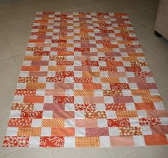 "Oliver's orange quilt.  The large rectangles are supposed to be 7.5"" long by 3.5"" wide, I made mine a quarter inch smaller so 7 and a quarter long x 3.5"" wide, this allowed me to cut 6 pieces from a 42"" x 3.5"" strip."