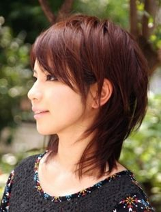 Medium messy hairstyle for Asian women. Love the cut and color.