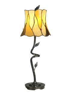 Delicate grace defines our twisted leaf Tiffany buffet lamp. The dainty shade features 21 pieces of beige and light amber art glass set in a leaf pattern. Green leaves in intervals around the shade...