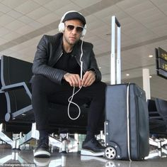 The 33-year-old defender, who will join Juventus, looks cool as he waits in an airport ahead of a flight