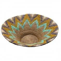 This bowl is crafted entirely from locally-sourced, natural fibres and recycled materials.