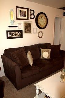 Amazing Wall Grouping For Living Room Great Picture Arrangement Oar And Clock Mix With Other Over Couch Family