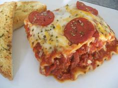 Pizza Lasagna from Food.com:   								My kids are not overly fond of ground beef and this recipe is a creative way to make lasagna without it. I will usually make 2 lasagne at one time and freeze the other one for a quick meal at a later date.